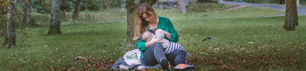 breastfeeding in park mom baby nature weaning